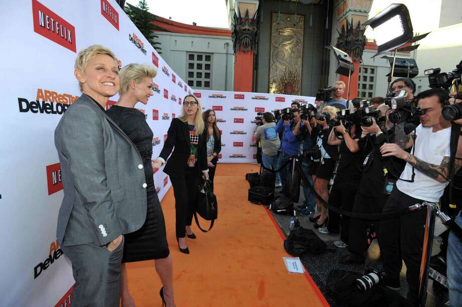 "Ellen DeGeneres, left, and Portia de Rossi pose for photographers at the season four premiere of ""Arrested Development"" at the TCL Chinese Theatre on Monday, April 29, 2013 in Los Angeles. Photo: John Shearer, John Shearer/Invision/AP / Invision"