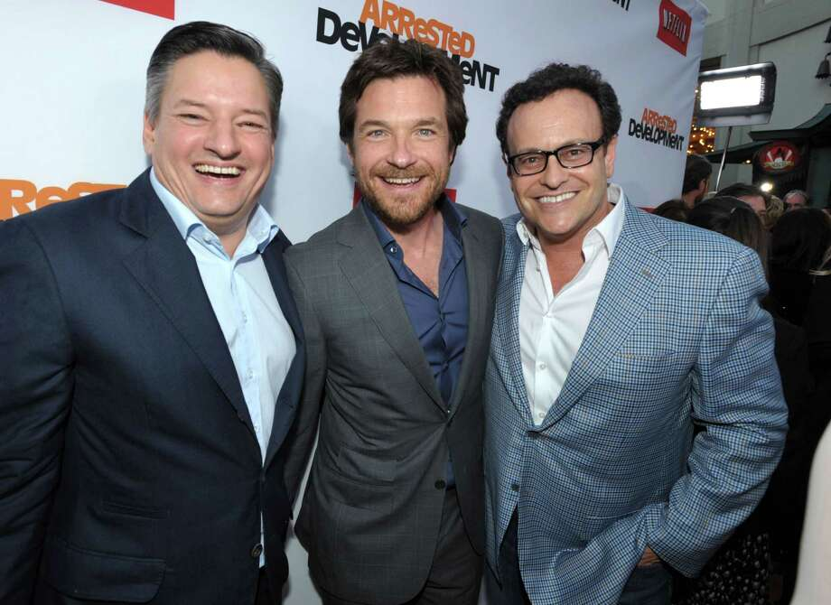"From left, Ted Sarandos, Jason Bateman, and Mitchell Hurwitz attend the season four premiere of ""Arrested Development"" at the TCL Chinese Theatre on Monday, April 29, 2013 in Los Angeles. Photo: John Shearer, John Shearer/Invision/AP / Invision"