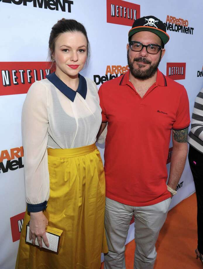 "Amber Tamblyn, left, and David Cross arrive at the season four premiere of ""Arrested Development"" at the TCL Chinese Theatre on Monday, April 29, 2013 in Los Angeles. Photo: John Shearer, John Shearer/Invision/AP / Invision"
