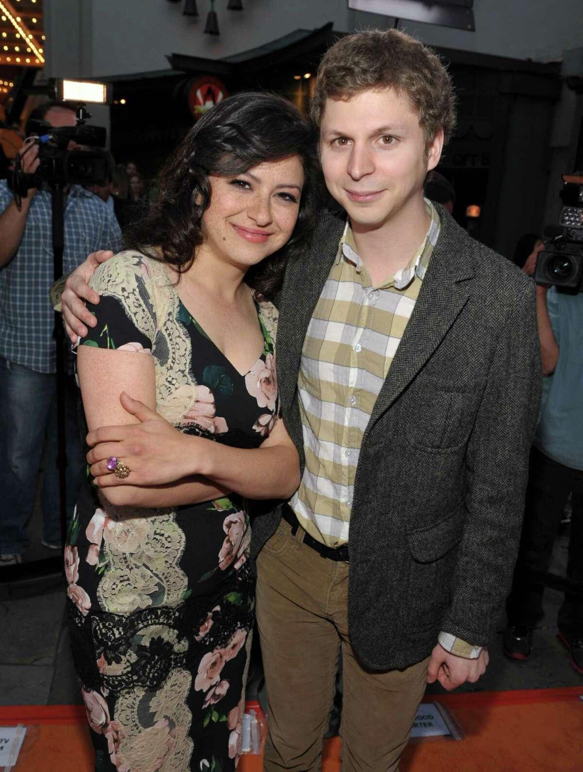 Alia Shawkat, left, and Michael Cera attend the season four premiere of