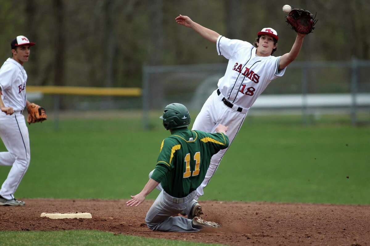 Trinity Catholic ballplayer Matt Christensen is safe at second for a succesful steal as New Canaan infielder Brandon Abate takes the high throw from the catcher. New Canaan held Trinity to four hits, in winning, 2-1. © J. Gregory Raymond for The Advocate