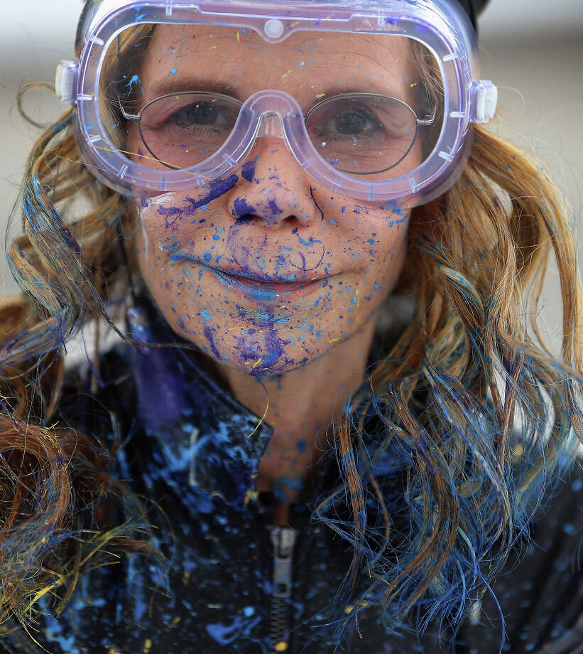 Artist Princess Tarinan von Anhalt poses, covered in paint, as she works on a piece of art using the air flow coming from the engine of Flexjet's Learjet 40 XR engine at Signature Flight Support on April 30, 2013 in West Palm Beach, Florida.  The artist associated with the Jet Art Group used the help of Flexjet and their plane to spray paint on a canvas to create distinctive paintings to celebrate the 50th anniversary of Learjet. Photo: Joe Raedle, Getty Images / 2013 Getty Images