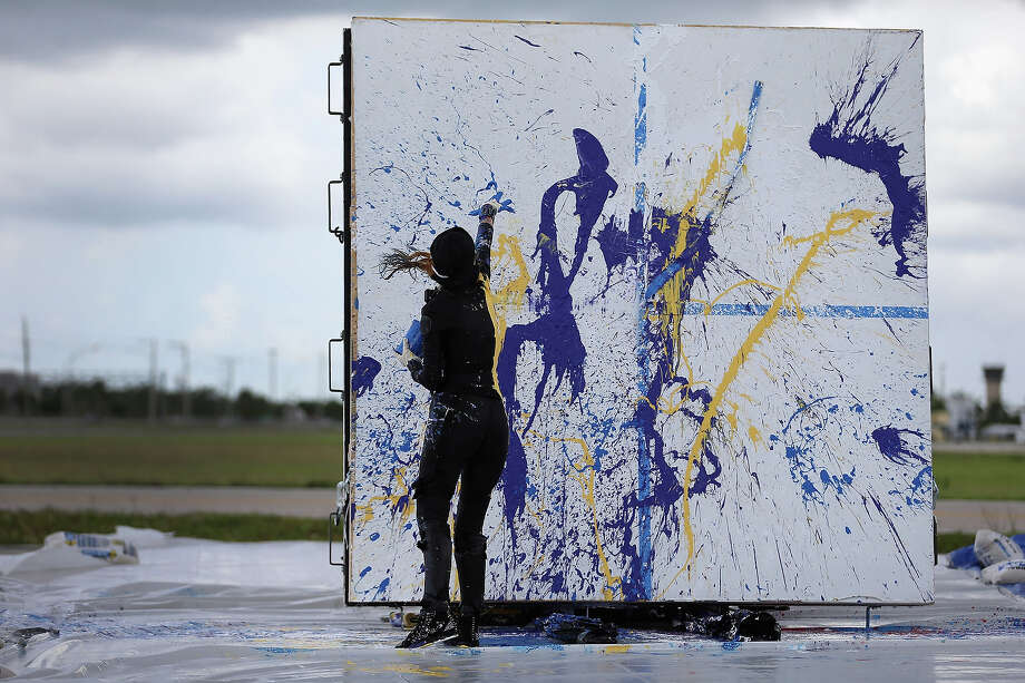 Artist Princess Tarinan von Anhalt works on a piece of art using the air flow coming from the engine of Flexjet's Learjet 40 XR engine at Signature Flight Support on April 30, 2013 in West Palm Beach, Florida.  The artist associated with the Jet Art Group used the help of Flexjet and their plane to spray paint on a canvas to create distinctive paintings to celebrate the 50th anniversary of Learjet. Photo: Joe Raedle, Getty Images / 2013 Getty Images