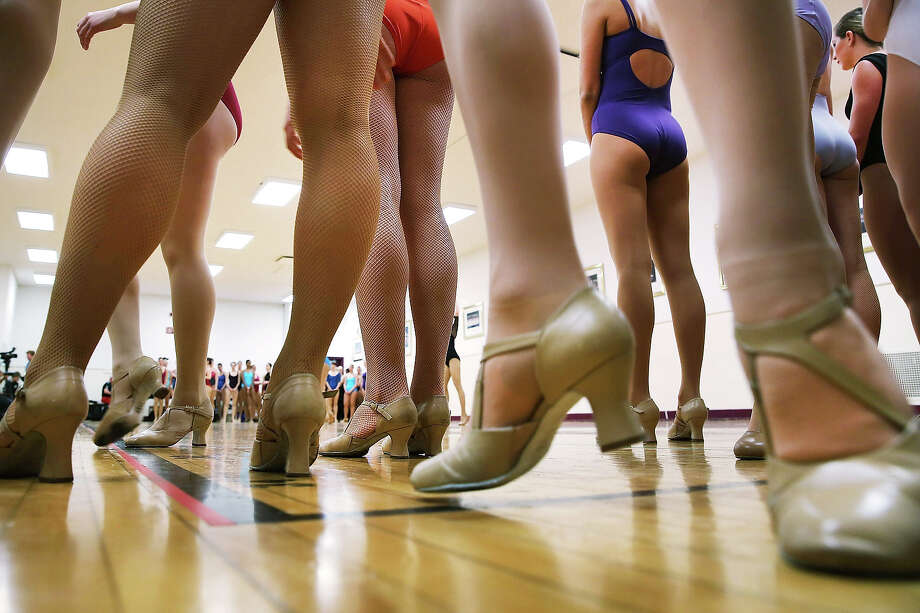 Woman audition at Radio City Music Hall for a spot with the Rockettes on April 30, 2013 in New York City. In order to be considered for the Rockettes, dancers must be at least 18 years old, measure at a height between 5 feet 6 inches and 5 feet 10 1/2 inches without their heels on. The dancers must also be  be proficient in numerous dance styles, including jazz, tap and ballet. The women who make it through the extremely competitive competition to land a spot with the legendary dance group will perform in the Radio City Christmas Spectacular which runs from November 8 -December 30 2013. Photo: Spencer Platt, Getty Images / 2013 Getty Images
