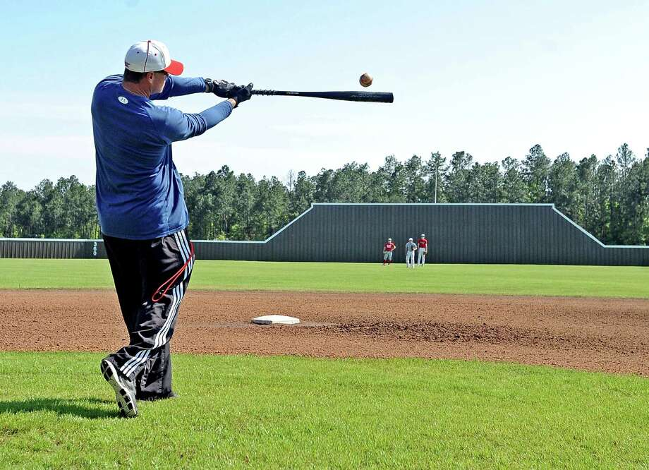 Lumberton High School baseball coach Michael Stewart hits an array of fly balls to outfielders during practice on Wednesday, April 24, 2013. Photo taken: Randy Edwards/The Enterprise Photo: Randy Edwards