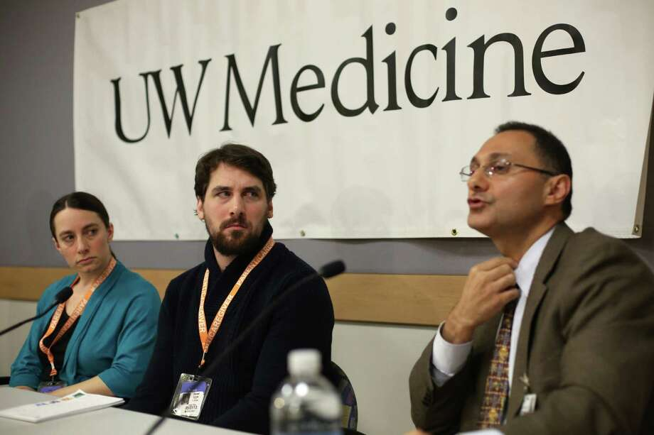 Dr. Saman Arbabi, acute care section head at Harborview Injury Prevention and Research Center, explains the tracheotomy on Karina Schulte as Dan and his sister Marilyn Schulte listen during a press conference. Photo: JOSHUA TRUJILLO, SEATTLEPI.COM / SEATTLEPI.COM