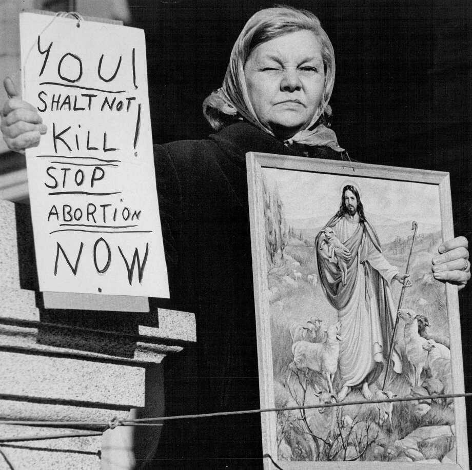 1970; No Question About Her Sentiment; Mrs. Helen Fields, an anti-abortion supporter, Stood with this sign in front of the speakers' area on the State Capitol steps Sunday facing a crowd of about 1,000 persons throughout the program. The rally on the Capitol's west steps later moved to the Cathedral of the Immaculate Conception for an interdenominational service. Mrs. Fields is the mother of seven. Speakers included a doctor and state legislator.; Photo: John G. White, Getty Images / (C) 2010 The Denver Post, MediaNews Group