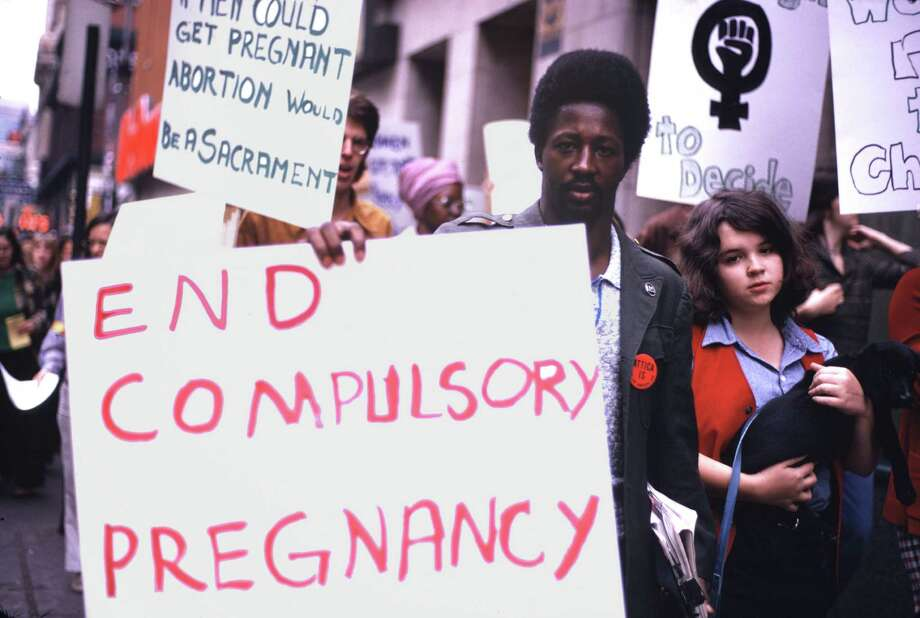 "1974: A man participates in a protest march and carries a sign reading ""End Compulsory Pregnancy"" at reproductive rights demonstration in Pittsburgh. Photo: Barbara Freeman, Getty Images / Copyright 1974, Barbara Freeman"