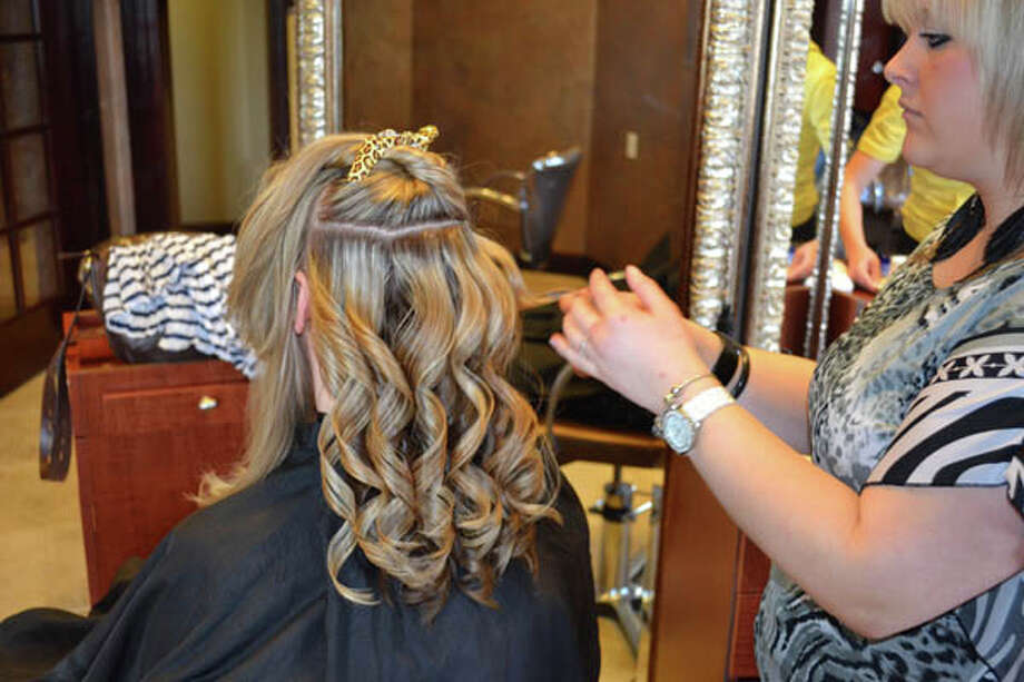 Tiffany getting her hair done for the cover shoot at Kimberley's A Day Spa in Latham.