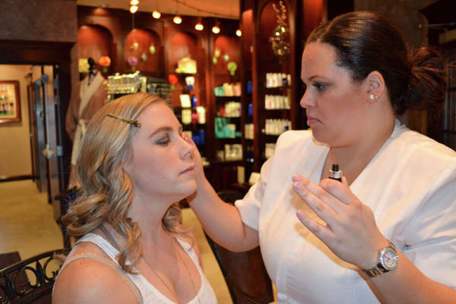 Tiffany getting her makeup done for the cover shoot at Kimberley's A Day Spa in Latham.