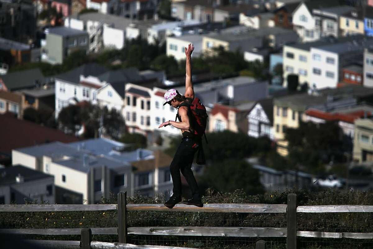 A man walks along a railing in Grand View Park, also known as Turtle Hill, on April 18, 2013 in the Golden Gate Heights neighborhood of San Francisco, Calif.