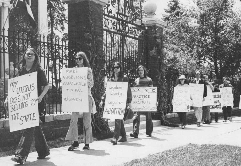 "1971: About 25 demonstrators, mostly women, picketed the governor's mansion in Denver, Colo. Carolyn Jasin, a protest spokesman said abortion should be a ""private matter"" between patient and physician not subject to regulation. Photo: Bill Peters, Getty Images / (C) 2010 The Denver Post, MediaNews Group"