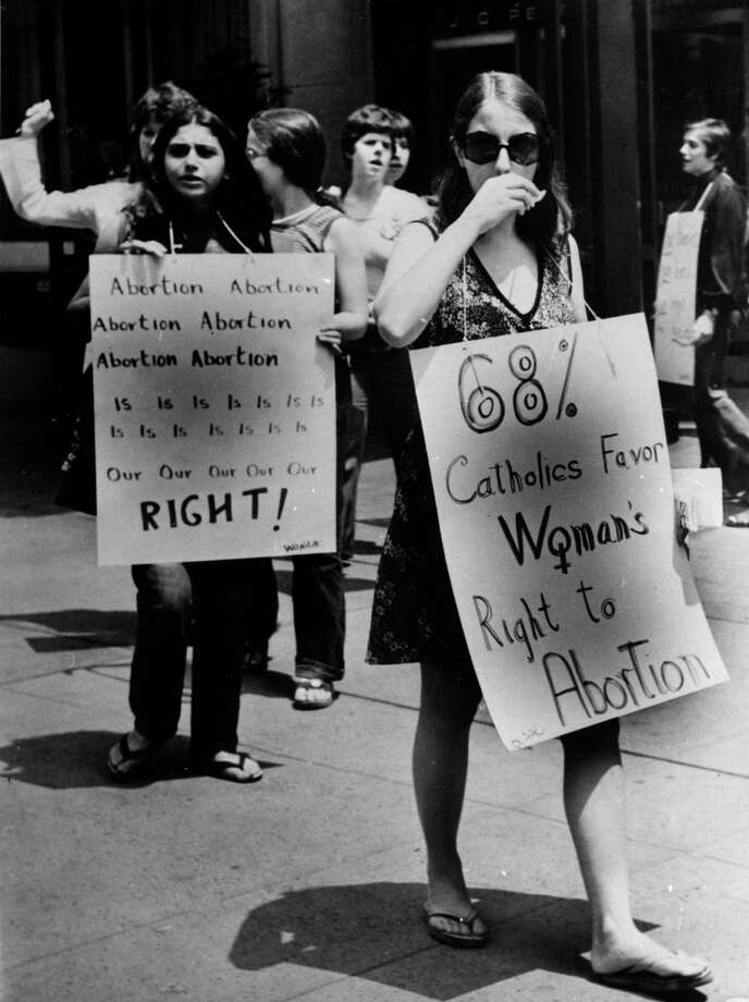 1973: Pro-choice campaigners at a demonstration in favor of abortion in front of the American Hotel in mid-town New York, where the American Medical Association was holding its annual convention. Photo: Peter Keegan, Getty Images / Hulton Archive