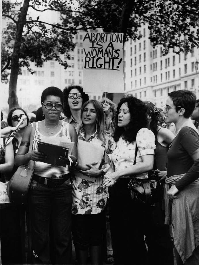 1972: Members of the New York women's Liberation Army demonstrate on a street corner to demand abortion rights. Photo: Peter Keegan, Getty Images / Hulton Archive