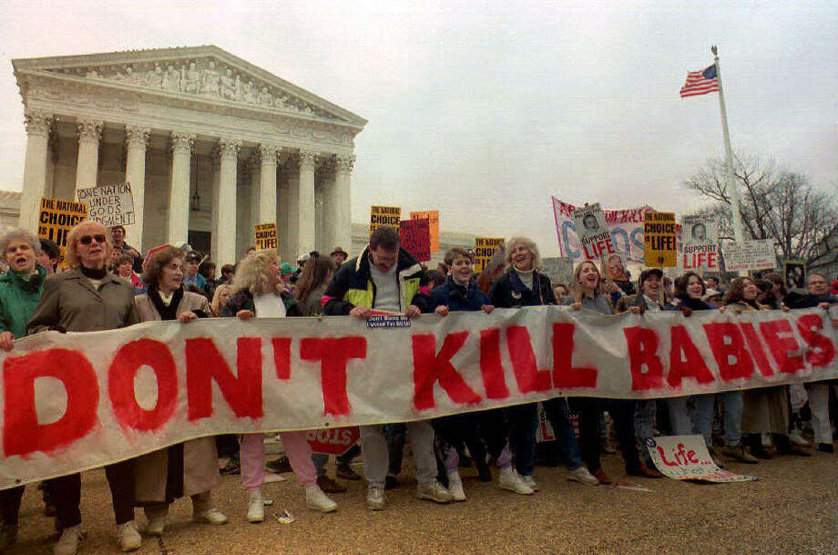 1993: Demonstrators chant in front of the US Supreme Courti n this Jan. 22 1993 file photo during the Right-to-Life March on the 20th anniversary of the Supreme Court decsion Roe vs. Wade. Photo: KIRSTEN BREMMER, Getty Images / 2008 AFP
