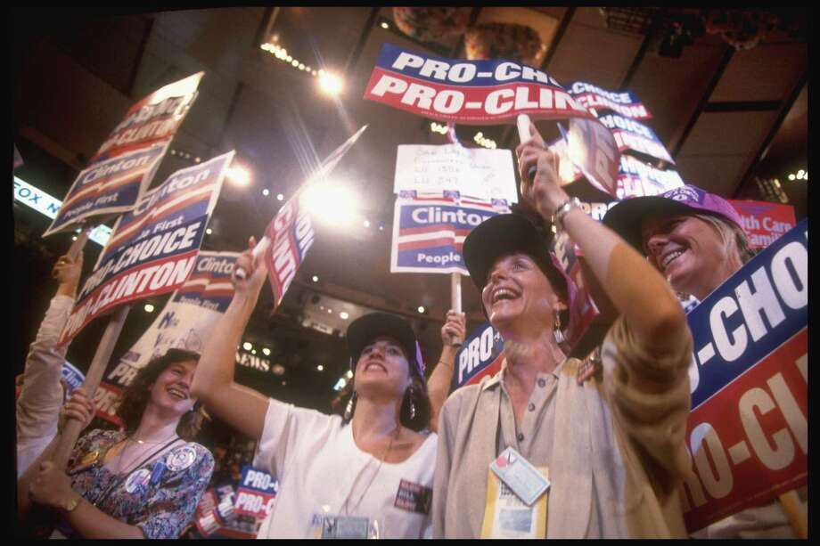 1992: Women waving PRO-CHOICE PRO-CLINTON signs supporting candidacy of Bill Clinton, on floor of Dem. Natl. Convention. Photo: Steve Liss, Getty Images / Steve Liss
