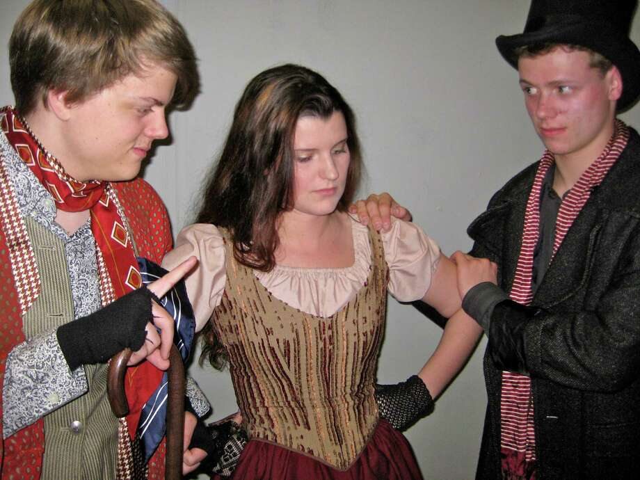 Will Powers, far left, plays Fagin in Fairfield Ludlowe High School Drama Club's production of Lionel Bart's 'Oliver!,' while Katie Middleton, center, portrays Nancy and Tim Dutter, far right, plays Bill Sykes. The musical will be performed Friday, May 3, and Saturday, May 4. Photo: Contributed Photo