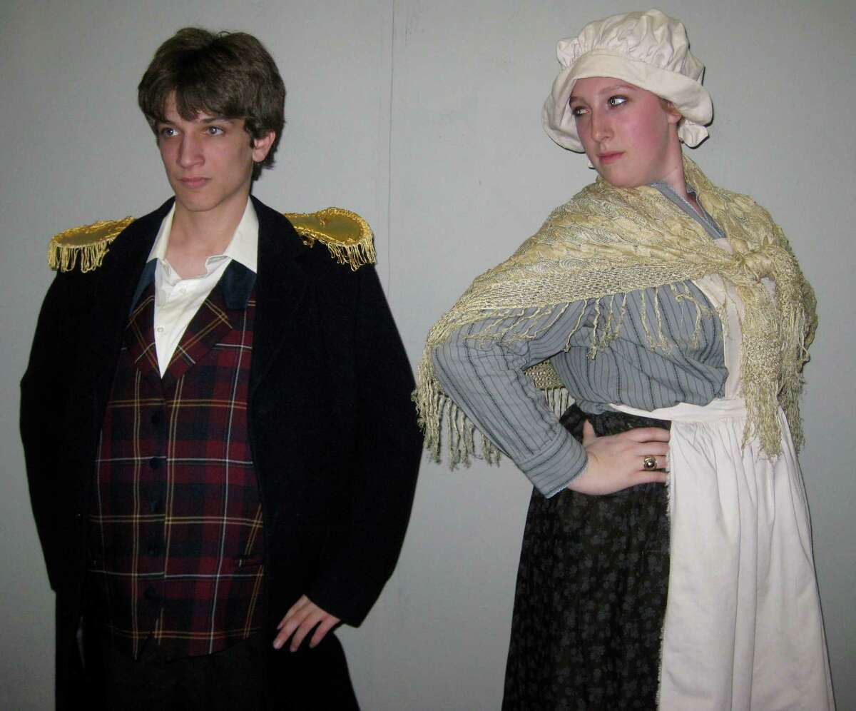 James Purcell, left, plays Mr. Bumble while Kaitlyn Carruthers portrays Widow Corney in Fairfield Ludlowe High School Drama Club's production of 'Oliver!,' to be performed on Friday, May 3, and Saturday, May 4.