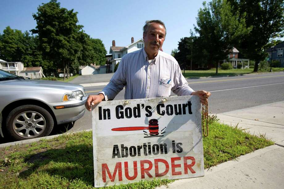2007: Outside the Glens Falls Planned Parenthood building on Aug. 1, 2007, Steven Solimanto, 57 years, protests what he calls a pro-abortion policy by the non-profit charity in Glens Falls, New York. Photo: Robert Nickelsberg, Getty Images / 2007 Robert Nickelsberg