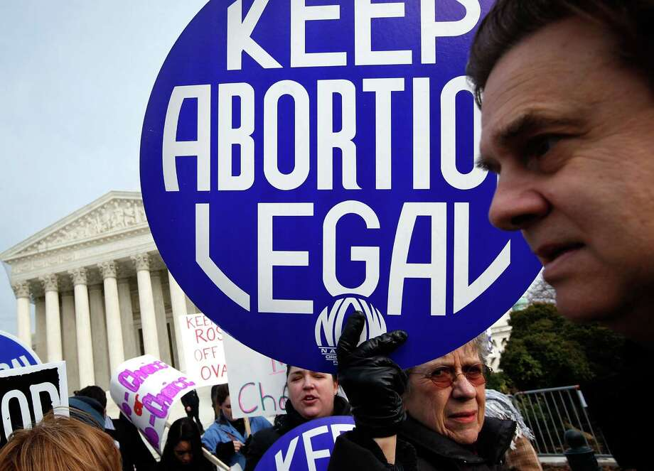 "2010: A pro-choice activist holds up a sign during the annual ""March for Life"" event in front of U.S. Supreme Court January 22, 2010 in Washington, DC. Photo: Alex Wong, Getty Images / 2010 Getty Images"