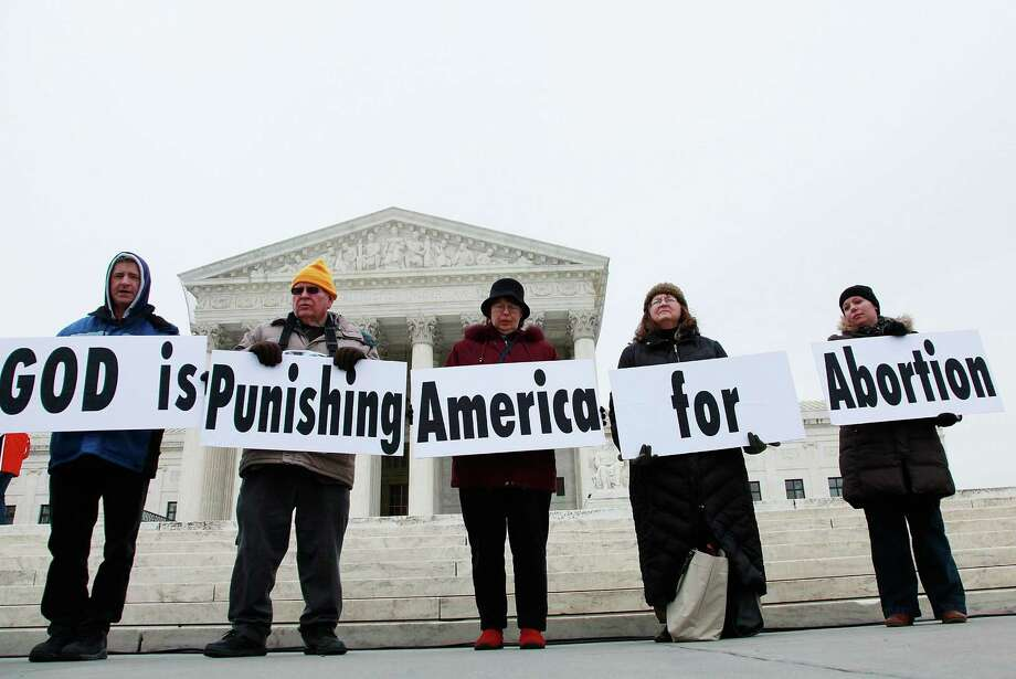 2010: Pro-life supporters participate in a protest in front of the U.S. Supreme Court building Jan. 22, 2010 in Washington, DC. Photo: Mark Wilson, Getty Images / 2010 Getty Images
