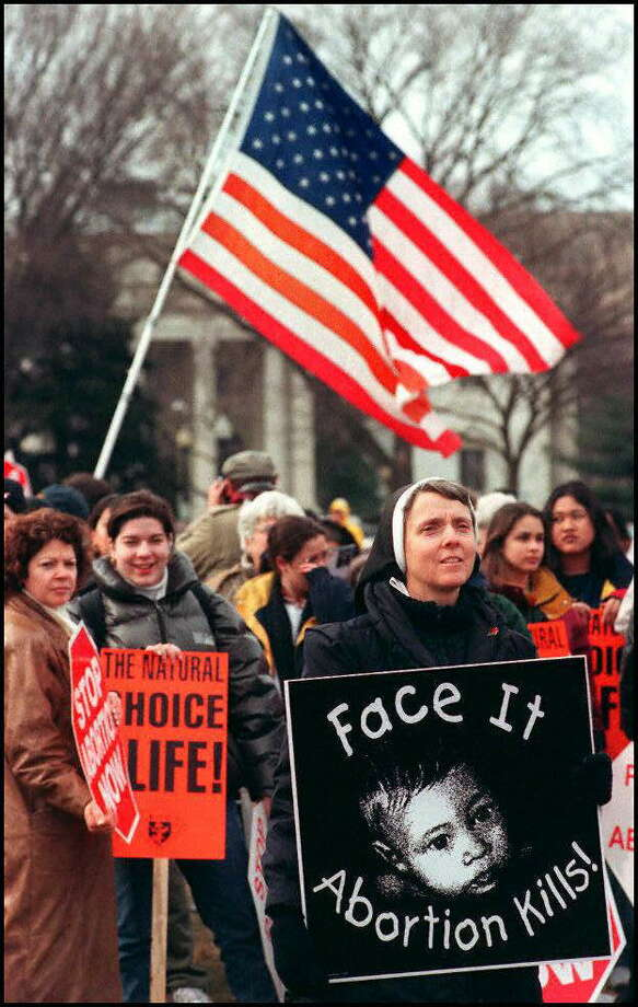 1997: Sister Yvonne Cusson(R) participates with hundreds of right to life demonstraters from across the US in marching from the White House to the US Supreme Court Building during the annual march. Photo: JOYCE NALTCHAYAN, Getty Images / AFP