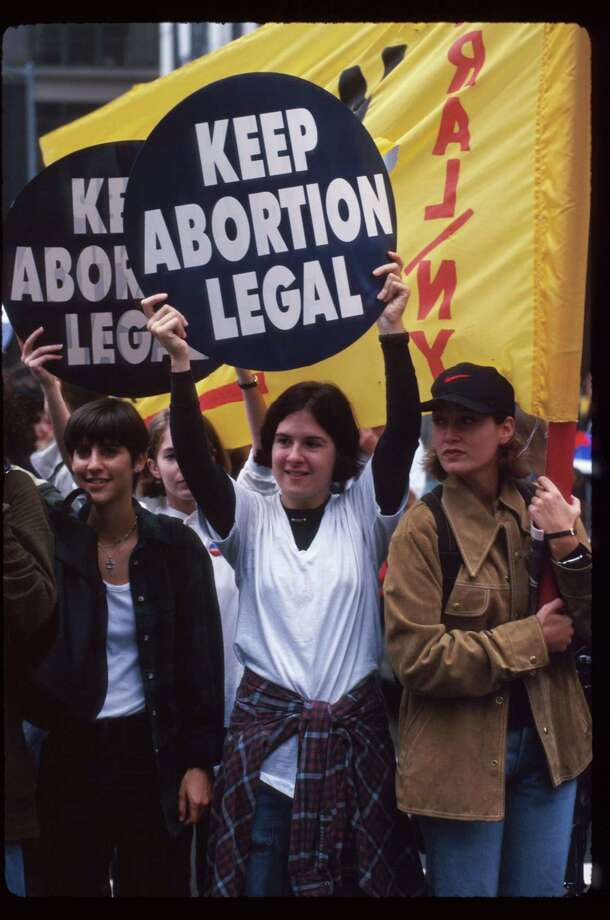 1995: Protestors hold up signs at the Women's Rights rally October 7, 1995 in New York City. (Photo by Evan Agostini/Liaison) Photo: Evan Agostini, Getty Images / Getty Images North America