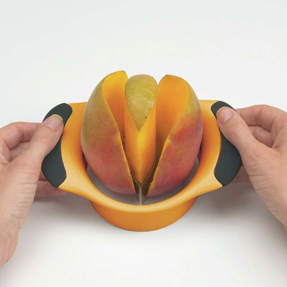 Those smart cookies at OXO are always coming up with clever gadgets. Among the new products introduced this year is the Mango Splitter, which removes the pit and slices a mango in one press. Photo: Oxo / Oxo