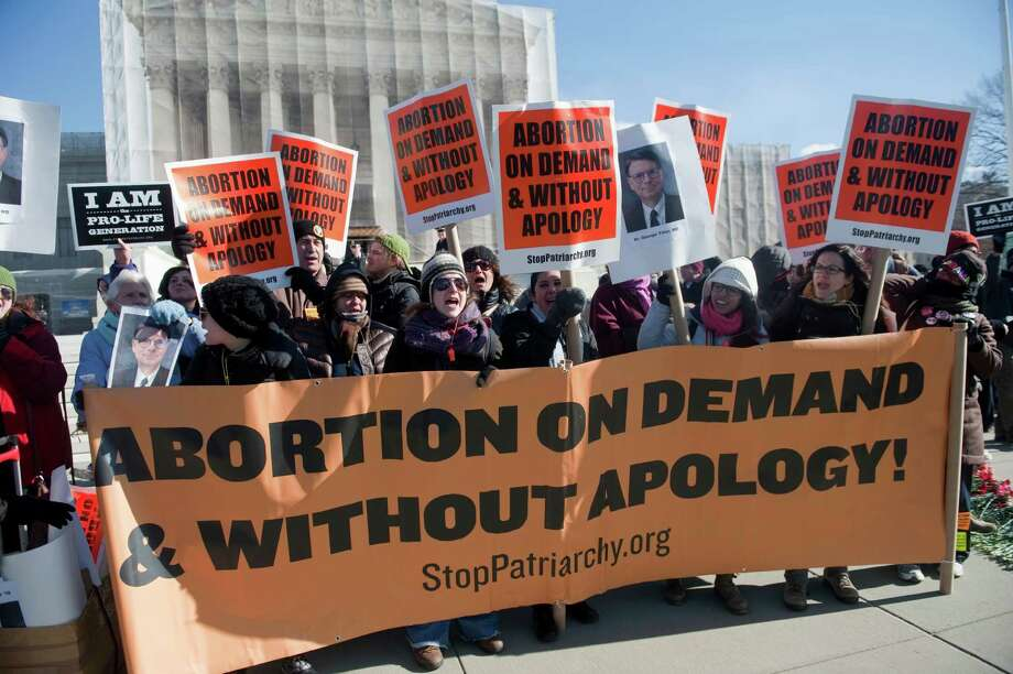 """Members of """"Stop Patriarchy"""" demonstrate to support legal abortions in front of the Supreme Court in 2013. Photo: Chris Maddaloni, Getty Images / © 2013 CQ Roll Call"""
