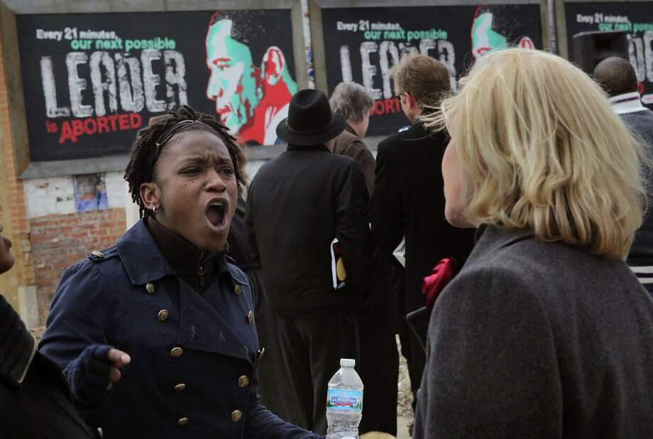 2011: Aisha Truss-Miller (L) and Ann Scheidler (R) express their opposing views following the dedication of controversial pro-life billboards depicting U.S. President Barack Obama on March 29, 2011 in Chicago, Ill. Photo: Scott Olson, Getty Images / 2011 Getty Images