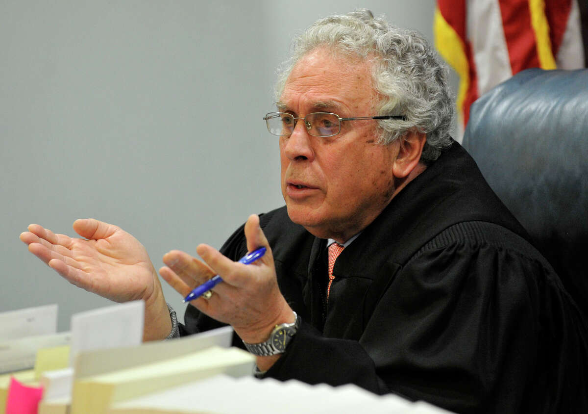 Judge Thomas Bishop talks to opposing counsel at Michael Skakel's habeas corpus trial at State Superior Court in Vernon, Conn., on Tuesday, April 30, 2013.