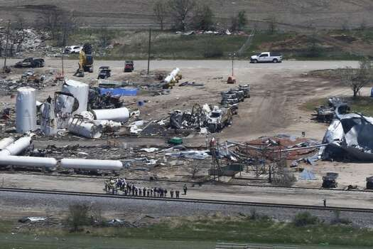 Damage from the West, Texas, fertilizer plant explosion is seen from helicopters. (AP Photo/Charles Dharapak)