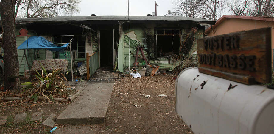 This is the scene Tuesday, Feb. 18, 2014, of a fatal fire that claimed two lives last night in the 2000 block of Basse Road. Photo: JOHN DAVENPORT, SAN ANTONIO EXPRESS-NEWS / ©San Antonio Express-News/Photo may be sold to the public