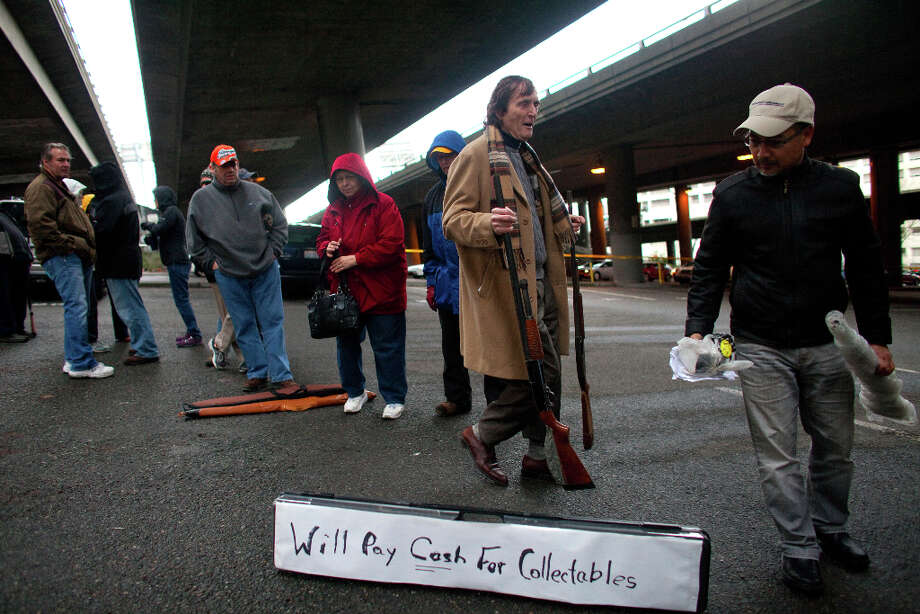 People wait line during the City of Seattle's gun buy back program under Interstate 5 on Saturday, January 26, 2013. The program handed out $80,000 worth of gift cards in exchange for weapons brought in by the public. Photo: JOSHUA TRUJILLO, SEATTLEPI.COM / SEATTLEPI.COM
