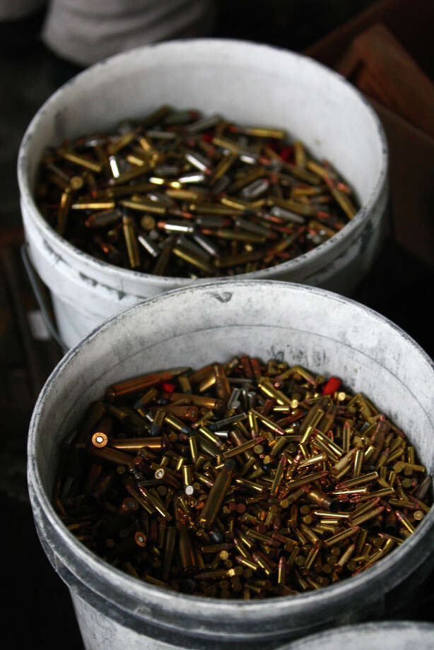 Buckets of collected ammunition are shown during the City of Seattle's gun buy back program on Saturday, January 26, 2013. The program handed out $80,000 worth of gift cards in exchange for weapons brought in by the public. Photo: JOSHUA TRUJILLO, SEATTLEPI.COM / SEATTLEPI.COM