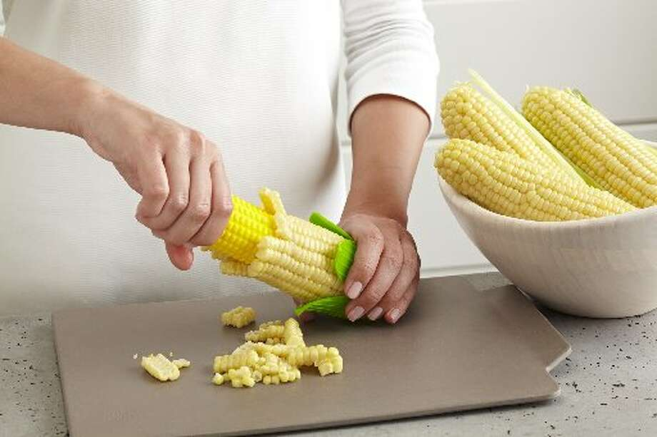 Seems a lot of folks are looking for easy ways to remove corn kernels from the cob. Kuhn Rikon entered the niblets ring this year with the Corn Twister, a device that looks like an ear of corn. Hands are fully protected by this gadget that strips kernels from the cob with a smooth and simple twist and push.