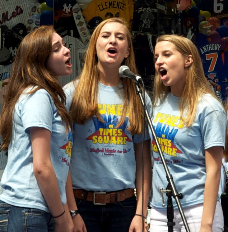 Magical Music For Life singers Alexa Holzberger, Sara Norton, and Christie Coco, all of New Canaan, performed at Tunes in Times Square last year. The New Canaan-based organization performs in Times Square, New York City again this year on Sunday, May 5.