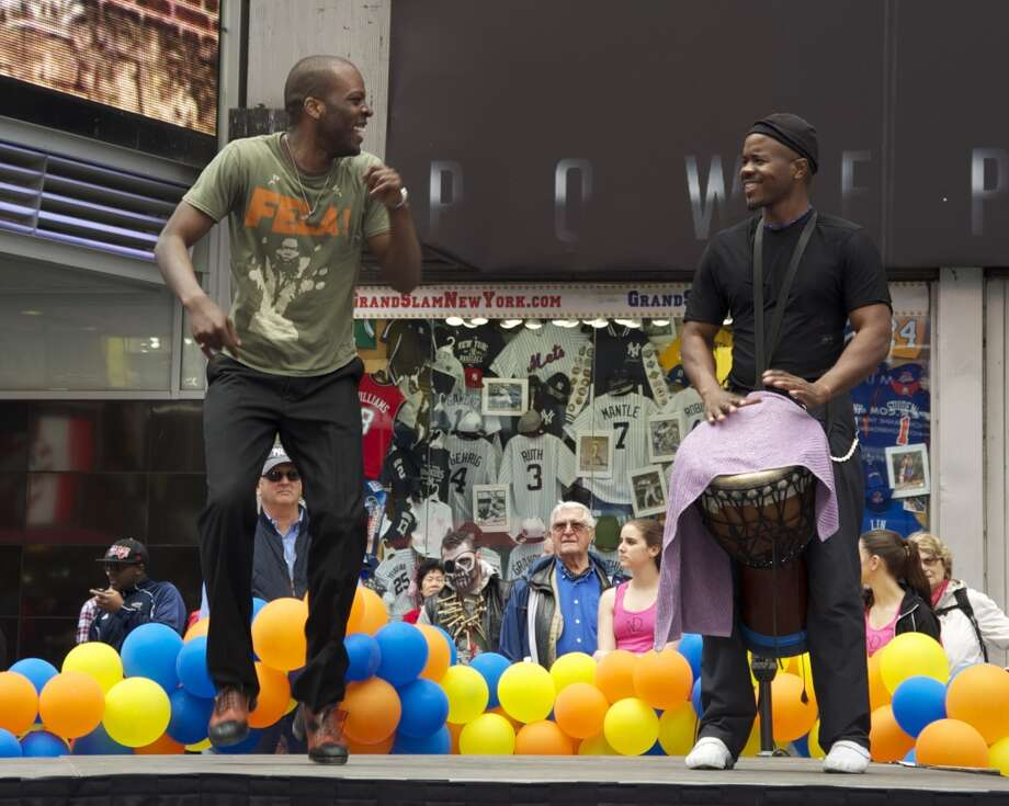 """J L Williams, a cast member from the Broadway production """"FELA!"""" and an instructor at New Canaan Dance Academy, performs with Magical Music For Life at Tunes in Times Square last year. The New Canaan-based singing group performs in Times Square, New York City again this year on Sunday, May 5."""