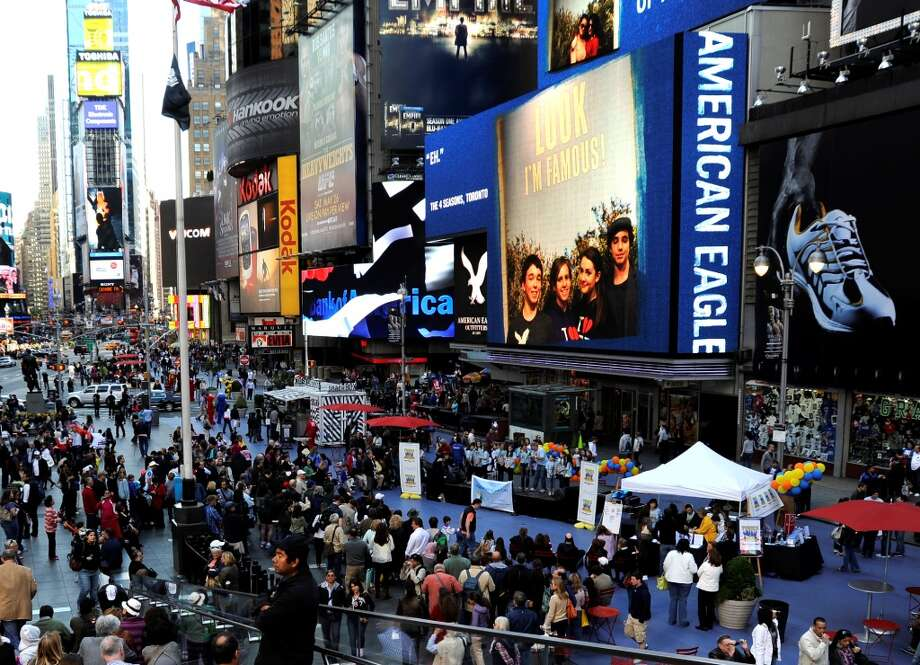 Crowds gathered to watch Magical Music For Life perform Tunes in Time Square last year.  The New Canaan-based singing group will perform in Times Square, New York City again this year on Sunday, May 5.