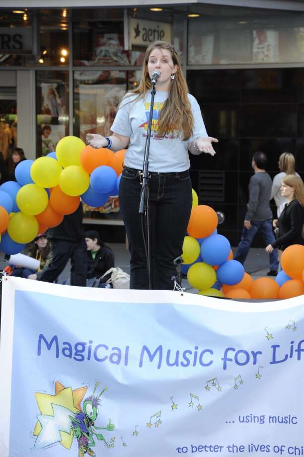 Kathryn Crum, of New Canaan, a former member of Magical Music For Life, performs with the New Canaan-based singing group at Tunes in Times Square last year. The group performs in Times Square, New York City again this year on Sunday, May 5.