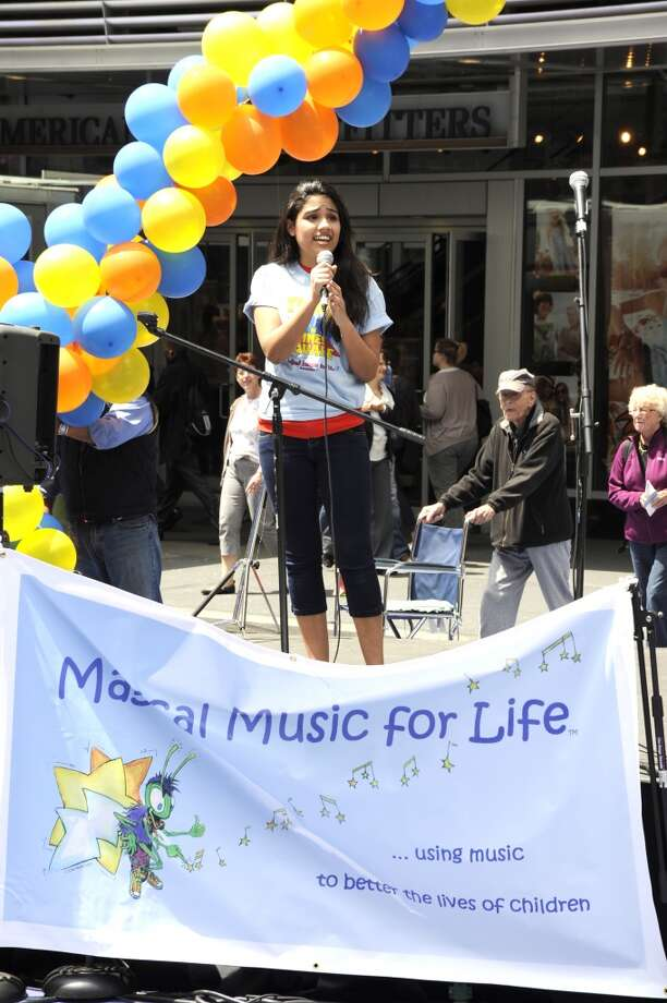 "Brianna Gentilella, a Broadway performer from ""How the Grinch Stole Christmas,""performed with Magical Music For Life at Tunes in Times Square last year. The New Canaan-based singing group performs in Times Square, New York City again this year on Sunday, May 5."