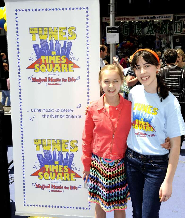 Broadway singer Madeleine Rose Yen, of Stamford, and Megan Mistretta, of Wilton, a Magical Music For Life singer, performed at Tunes in Times Square last year. The New Canaan-based singing group performs in Times Square, New York City again this year on Sunday, May 5.