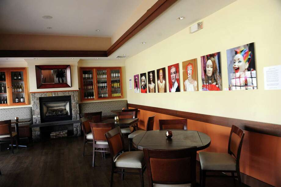 The Bistro Latino had a smaller dinning room with a fireplace at 1392 East Putnam Avenue, in Old Greenwich, Conn., Tuesday, April 8, 2013. Photo: Helen Neafsey / Greenwich Time