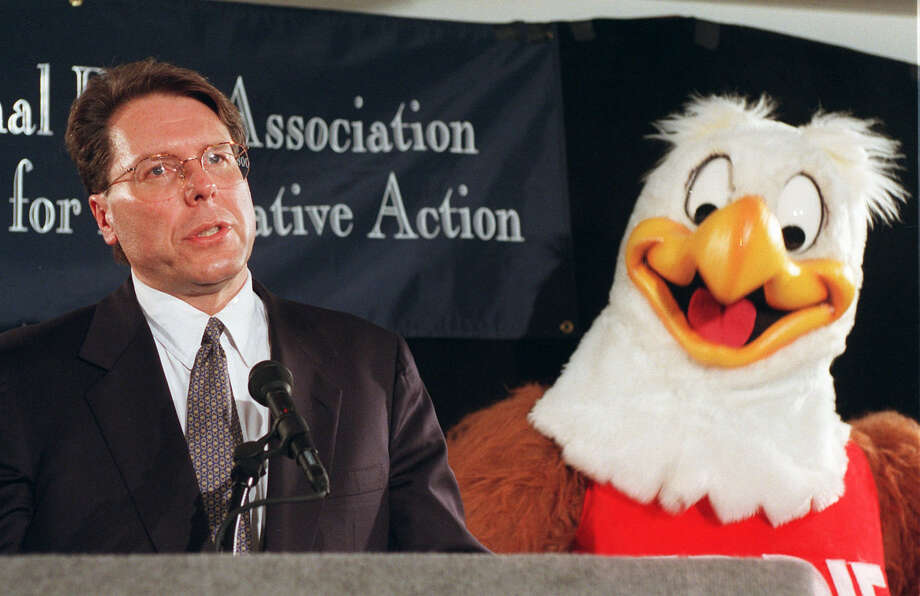 National Rifle Association gun safety mascot Eddie Eagle stands beside Wayne LaPierre, NRA executive vice-president, during a news conference in Washington Friday, Feb. 28, 1997, to mark the third anniversary of the Brady Act. Photo: Dennis Cook/AP