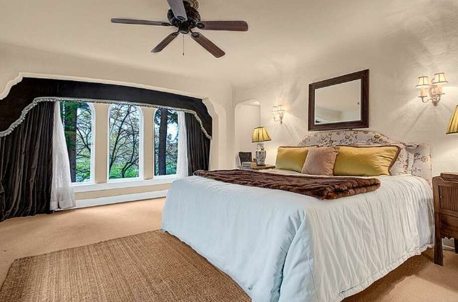 Bedroom of 2459 E. Lake Washington Boulevard. The 3,150-square-foot Mediterranean-style house, built in 1927, has four bedrooms, 2.25 bathrooms, leaded glass, arched doorways and windows, coved ceilings, built-ins, a rec room and a brick patio on a 4,944-square-foot lot. It's listed for $959,000. Photo: HD Estates,  Courtesy Mark Rockwell,  Windermere Real Estate