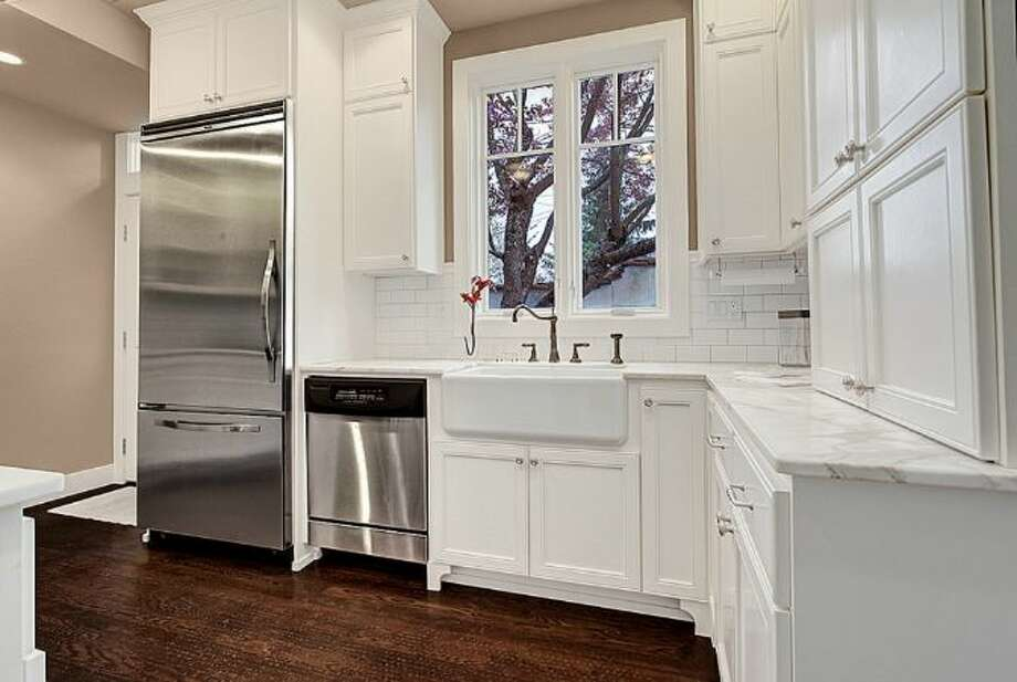 Kitchen of 2459 E. Lake Washington Boulevard. The 3,150-square-foot Mediterranean-style house, built in 1927, has four bedrooms, 2.25 bathrooms, leaded glass, arched doorways and windows, coved ceilings, built-ins, a rec room and a brick patio on a 4,944-square-foot lot. It's listed for $959,000. Photo: HD Estates,  Courtesy Mark Rockwell,  Windermere Real Estate