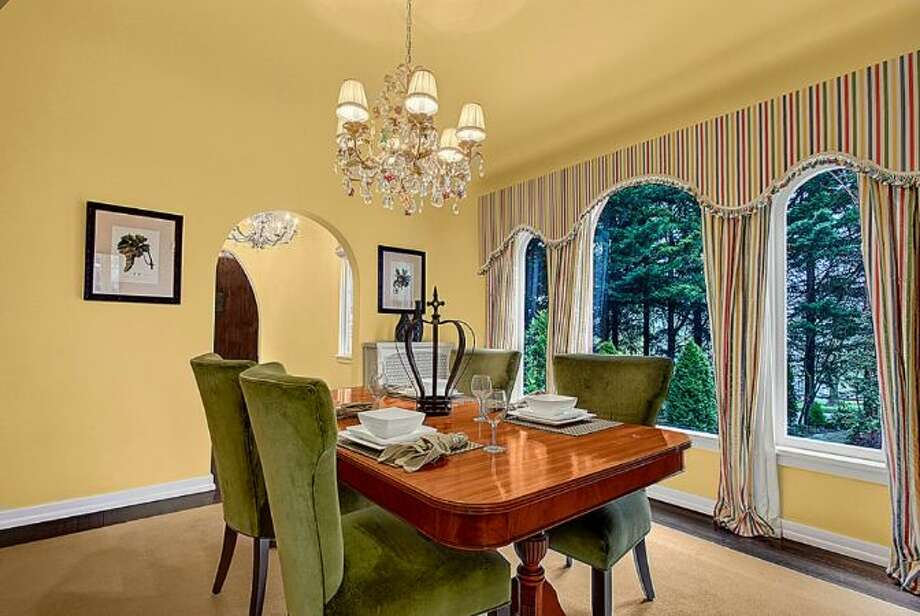 Dining room of 2459 E. Lake Washington Boulevard. The 3,150-square-foot Mediterranean-style house, built in 1927, has four bedrooms, 2.25 bathrooms, leaded glass, arched doorways and windows, coved ceilings, built-ins, a rec room and a brick patio on a 4,944-square-foot lot. It's listed for $959,000. Photo: HD Estates,  Courtesy Mark Rockwell,  Windermere Real Estate