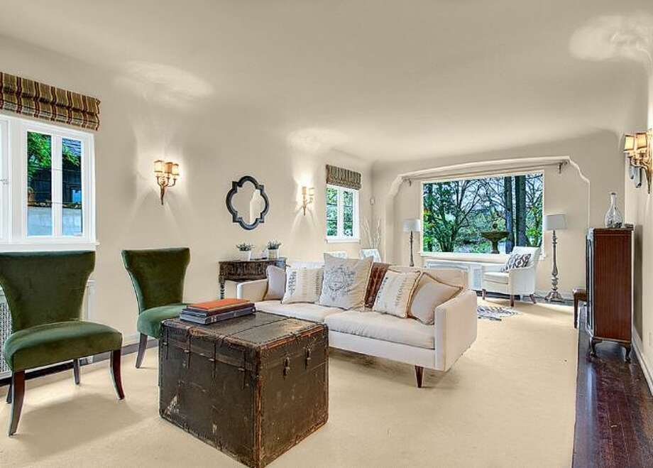 Living room of 2459 E. Lake Washington Boulevard. The 3,150-square-foot Mediterranean-style house, built in 1927, has four bedrooms, 2.25 bathrooms, leaded glass, arched doorways and windows, coved ceilings, built-ins, a rec room and a brick patio on a 4,944-square-foot lot. It's listed for $959,000. Photo: HD Estates,  Courtesy Mark Rockwell,  Windermere Real Estate