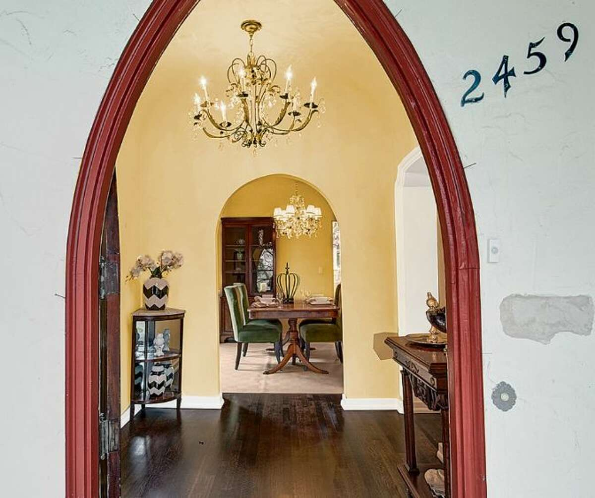 Entry of 2459 E. Lake Washington Boulevard. The 3,150-square-foot Mediterranean-style house, built in 1927, has four bedrooms, 2.25 bathrooms, leaded glass, arched doorways and windows, coved ceilings, built-ins, a rec room and a brick patio on a 4,944-square-foot lot. It's listed for $959,000.
