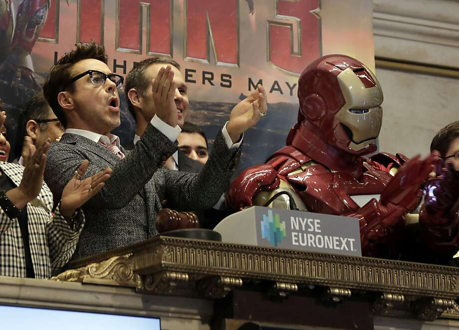 Bell ringer: Billionaire philanthropist playboy Tony Stark helps open the New York Stock Exchange on Wall Street. Photo: Richard Drew, Associated Press